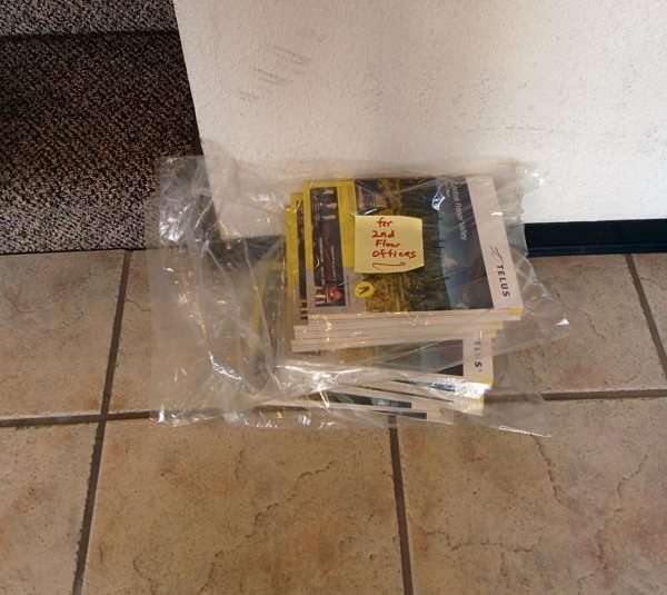 pile of phonebooks at bottom of stairs