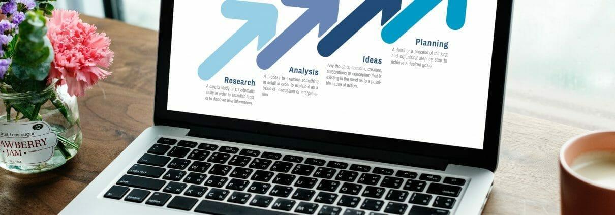 computer laptop showing marketing graph
