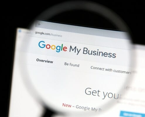 Magnifying Glass highlight Google My Business on a computer screen