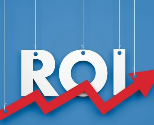 "Strings holding the letters that spell out ""ROI"" with red upward trend arrow"