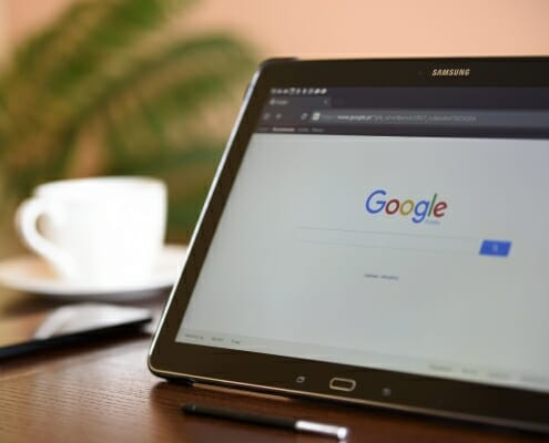 Google home page showing on a table screen