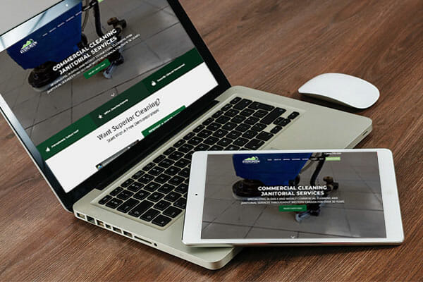 Evergreen Maintenance web page displayed on laptop and tablet