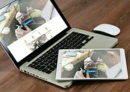 Goldcrosses.com website displayed on laptop & tablet